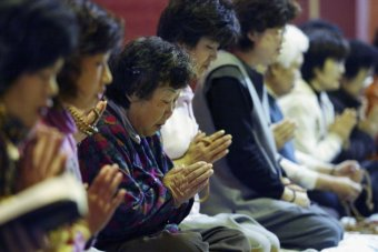 South Korea women pray for their children's success in the annual college entrance examination. Photo by Chung Sung-Jun/Thinkstock.